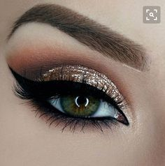Sparkly eye makeup; gold sparkle and brown eye look