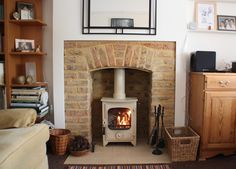 Original 1920's repointed brick chamber with cream tiled hearth and Charnwood Country 4 wood stove. Fitted in Chelmsford Essex 2006