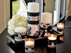 Personalize every aspect of your wedding day. You can start by decorating your own fashionable pillar candles.