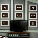 Sea-Inspired Gallery Wall - use spray painted shells, inexpensive frames, and brown linen to create a graphic display