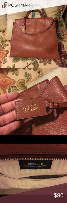 Kate Spade Saturday Tote Brown Kate Spade Saturday Tote.  Great condition.  One little smudge in liner, but otherwise perfect! kate spade Bags Totes