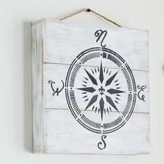 Make this nautical inspired DIY Compass Cradle Board Sign to give direction to your home decor.