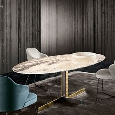 @minotti_spa #Catlin dining table available in surprising number of combinations of base materials from textured black-painted metal combined with bright chrome or bright gold finish. The beveled top also comes in various shapes: round, oval, and rectangular with surface from open pore moka lacquered oak to the polished arabescato marble.