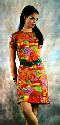Sixties model Marcha is wearing a bright colorful print dress by Korrigan, 1968