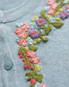 Handembroidered flowers on a bought H&M cardigan - @mooivandraad