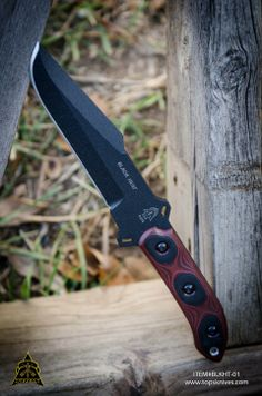 """Black Heat O/A Length:11"""" Blade Length:6 1/2"""" Cutting Edge:5 1/2"""" Thickness:1/4"""" Steel:1095 High Carbon Alloy Blade Color:Black Traction Coating Handle:Red/Black G-10 Sheath:Kydex Weight: 13.0oz Weight w/ Sheath: 16.4oz"""