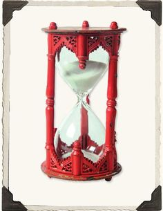 Gothic Sand  glass - paint it black or keep it red for the festive Goth.  Victoriantradingco.com  $29