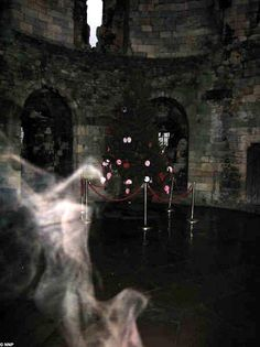 A mysterious ghostly shape has been caught on camera at one of Britain's oldest castles. The bizarre apparition, which cynics believe is a ...
