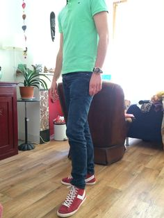 The green Polo is Nice for the summer, combined with the red sneakers makes it even more special. The dark jeans makes the picture complete.