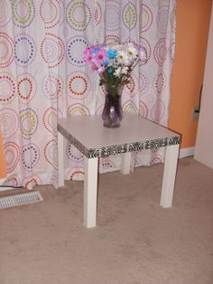 $8 Ikea end table with patterned duct tape around the edge!  Instant update!