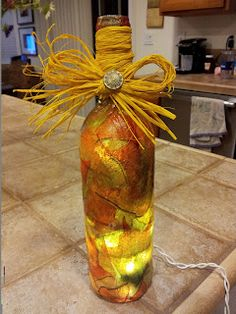 Recycled wine bottle into a night light!  mod podge magic!