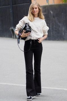 Just right for fall: a white cable-knit sweater and black flare jeans (see 49 other outfits here)