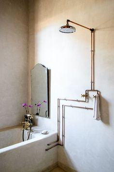 Exposed copper pipe in the bath