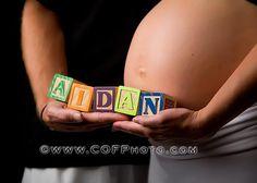 pregnancy belly name of baby in blocks photo idea