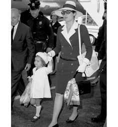 Princess Grace of Monaco—dressed in her signature impeccable style—and her daughter Stéphanie arrive on a Pan Am flight in New York on 6 June 1968.