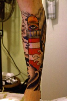 sinkorswimphoto:    My Leg half done. Lighthouse and ship in the sea. Little bit Scabby.  Tattoo done by Stevie Scott