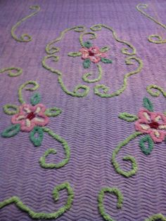 Purple Floral Chenille Bedspread.  Remember as a kid..plucking the spread just cuz it was fun.