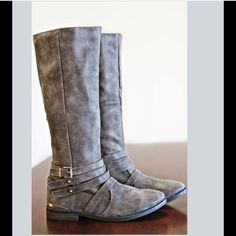 "⭐️SIZE 6⭐️ NIB Taupe Distressed Riding Boots ⭐️ONLY In 6⭐️Brand new, NIB Taupe Distressed Riding Boots. Awesome distressed look and strappy details at the ankles. Designed with a gold buckle and suede-like outer, these boots have a fully lined interior and padded footbed for comfort. Pull on style (no zipper) Boot height 15"", circumference 14"". RUNS TRUE TO SIZENo Trades and No Paypal⭐️PLEASE DO NOT PURCHASE THIS LISTING, COMMENT WITH SIZE AND I WILL MAKE A SEPARATE LISTING TO BUY⭐️Price is…"