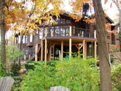 A larger deck on the back of a home.