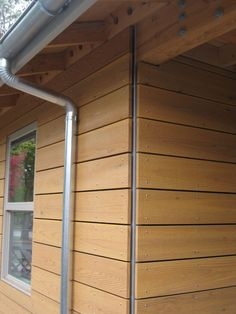 half round gutters and cedar rainscreen: