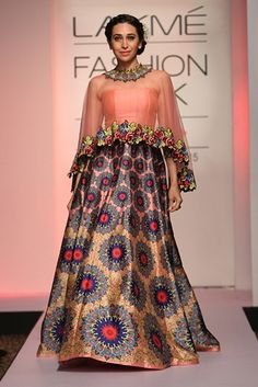 Karisma Kapoor for Neha Agarwal at Lakme Fashion Week Summer/Spring 2015. TO view, log on to: http://www.vogue.in/content/bollywood-showstoppers-lakme-fashion-week-summer-resort-2015#8