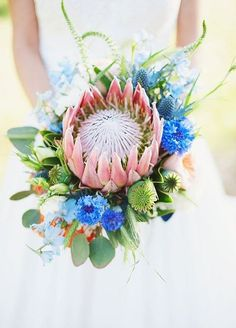 Brides: Modern Bouquet with Protea & Thistle. A modern bouquet comprised of king protea, thistle, delphinium, and eucalyptus, created by Posey Pop. Wedding Flower Photos, Blue Wedding Flowers, White Wedding Bouquets, Flower Bouquet Wedding, Floral Wedding, Protea Bouquet, Thistle Wedding, Protea Wedding, Diy Wedding