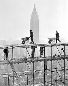 Construction of the United Nations building with the Empire State building in back.