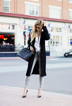 Gorgeous street style fashion! Black long coat, skinny jeans and heels...Women's fashion