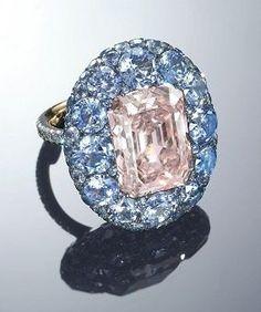 An 8.59-carat fancy pink VVS2 rectangular-shaped diamond and sapphire ring by JAR