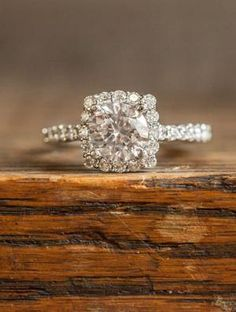 Pretty wedding / engagement ring. Square cut with halo of diamonds and accents on the band.