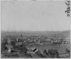 This is the oldest photograph of Elizabethton that I know of. The image dates to the 1800s. The antebellum courthouse was built in 1852. The West side of the Doe River, bare in the image, was not developed until after a new (15th) district was created specifically for the West side in 1897, five years after the covered bridge was built. Note there was no Elk Avenue bridge then. At some point in this time frame, a Co-Operative Town Company began selling ten million dollars of stock in…