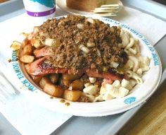The Garbage Plate, a college student late-night staple made famous at Nick Tahou's Hots in Rochester, is covered with the area's unique meat hot sauce.
