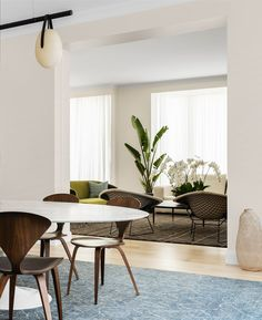 The informal dining area has an Eero Saarinen 'Ellipse' table and Cherner chairs all from De De Ce. 'Morocco' rug from Robyn Cosgrove. 'Gala' chandelier from Living Edge. The living area leads directly off this room. Knoll Bertoia 'Diamond' chairs from De De Ce.