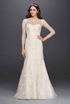 Feminine and elegant, this strapless trumpet gown is a classic! This 3/4 length sleeved dress features boatneck with elaborate leaf-like beaded lace applique on shoulders. Trumpet silhouette flows into an a-line beaded lace skirt. Sweep train. Sizes 0-14 and 16W-26W.  Available in store and online in Ivory and White. Back buttons. Imported. Dry clean only. Sizes 16W-26W. Also available in Plus Size, Petite, Extra Length, and Extra Length Plus Size.Check your local stores