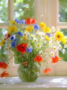 master painting vibrant blue flowers in arrangement - Googl