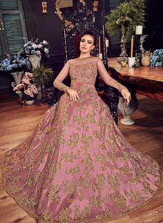 Pink and Gold Embroidered Net Anarkali Gown features a net kameez with santoon inner, santoon bottom and net dupatta. Embroidery work is completed with zari, thread and stone embellishments. Shadi Dresses, Pakistani Dresses Casual, Indian Gowns Dresses, Pakistani Wedding Dresses, Net Gowns Pakistani, Net Dresses, Pakistani Mehndi, Walima Dress, Mehndi Dress