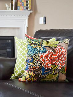 Pillow Arranging and Styling Tips -When a pillow ensemble lacks cohesion, often times the culprit is poor color flow. To solve the issue, look for pillows that are united by a key color.