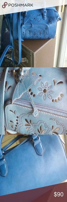 Handbag Stunning blue Danielle Nicole satchel.  Beautiful embroidery on the front, pockets and zip inside, outside zip in front.  Nice padded handle and shoulder strap.  New condition, big, delicious bag.  Thanks for stopping by! Danielle Nicole Bags Satchels