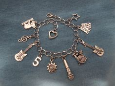 5 Seconds of Summer Charm Bracelet by alohabluedolphin 5sos Outfits, Concert Outfits, 5sos Merchandise, Piercings, Star Jewelry, Band Merch, Second Of Summer, 5 Seconds, Heart Charm