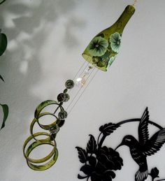 Wine bottle wind chime, Amber wind chime, Green flowers, yard art, patio decor, recycled bottle wind chime, hand painted chime by LindasYardArt on Etsy