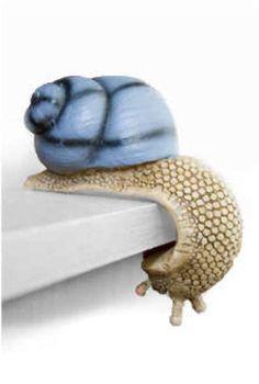 'Shelf Snails' Are Perfect for Bookworms and Grandmas #DIY trendhunter.com