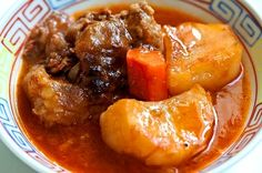 Island Oxtail Stew: What could possibly be better to feast your cravings than a batch of local style beef stew…well, perhaps a bowl of oxtail stew. A typical island style stew recipe, simmered with tender, juicy oxtail. | Cooking Hawaiian Style