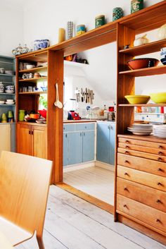 Pass-through shelves to separate kitchen and dining. Open yet separate.