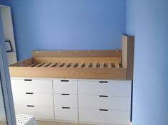 Here is what the Ikea Hack Children's cabin bed looked like after we had made the MDF headboard and MDF shelf against the back wall. We just need to paint it with white satinwood to match the Ikea Nordli drawers that we raised the bed frame onto. Click through to see our step-by-step guide.