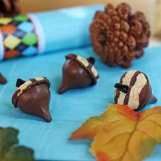 These fall-inspired cookies are made from kids' favorite sweets.                 Ingredients: Mini Keebler Fudge Stripe cookies Hershey's kisses Icing Black Licorice                  Make it:  Attach Hershey's kiss to bottom of a mini Keebler stripe cookie with a dot of icing. Place a small amount of icing in the center hole of the cookie and insert a short piece of black licorice for your stem.