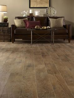 More realistic than ever, this laminate is reminiscent of reclaimed barn wood, complete with knotholes and saw marks. The oak-look floor (in ash color) gains authenticity from its wide plank size (6.25 inches). Photo courtesy of Mannington Mills, Inc.