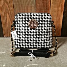❗️1 HR SALE❗️Classic Houndstooth Mini Handbag Brand New With Tags! Be classy & chic with this Classic Houndstooth Mini Handbag:) Has a 'spot free' exterior so if anything were to get on it you just wipe & it comes off!:) Description: Exquisite Exterior, Exterior Backside Zippered Pouch, Two Interior Pockets, Center Divider, Two Interior Zippered Pouches, Stunning Houndstooth Print Interior Design, Adjustable Shoulder/Crossbody Chained Strap.❗️️Depending on lighting the coloring can look…