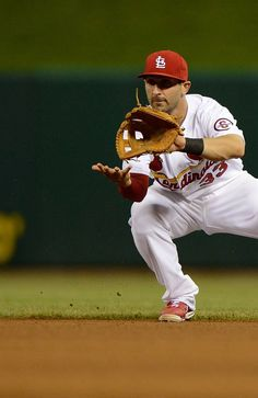 Daniel Descalso fields a ball during the 7th inning against the Reds.  Cards won 2-1.  4-30-13
