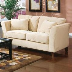 Loveseat...something not too formal. Probably in a darker color
