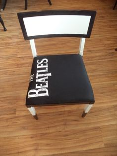 The Beatles!  Retro Modern chair in black and white with custom stencil. New padding added and reupholstered with Beatles tee shirt.